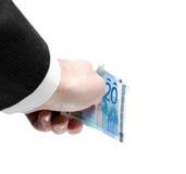 Man& x27; mano de s que lleva a cabo veinte notas euro Foto de archivo libre de regalías