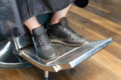 Man's legs in barber chair Royalty Free Stock Photos