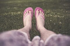 Man's feet in flip flops Royalty Free Stock Photos