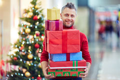 Man with xmas gifts Royalty Free Stock Image