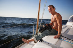 Man on yacht Royalty Free Stock Image