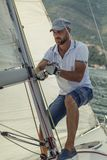 The man on the yacht controls the sail, beautiful seascape stock images