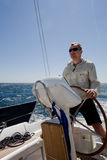 Man at yacht Helm Royalty Free Stock Photo