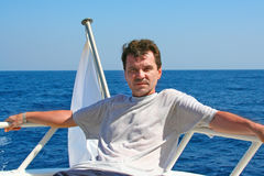 Man on a yacht in voyage Stock Image