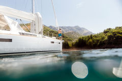 Man yachting blue lagoon. View from water stock photos