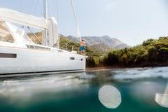 Man yachting blue lagoon Stock Photos