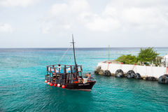 Man, yachtsman on motorboat on water, in St. John, Antigua Stock Photos