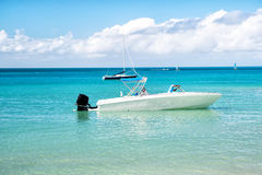 Man, yachtsman on motorboat on water, in St. John, Antigua Royalty Free Stock Photos