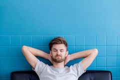 Man yawning and going asleep in his living room. The man yawning and going asleep in his living room Royalty Free Stock Photo