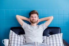 Man yawning and going asleep in his living room. The man yawning and going asleep in his living room Royalty Free Stock Photos