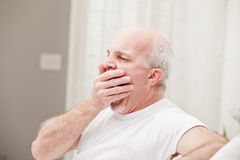 Man yawning and going asleep Stock Images