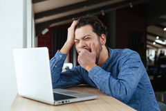 Man yawning in office Stock Photography