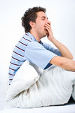 Man yawning and preparing for sleep Royalty Free Stock Photos
