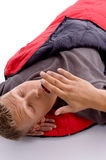 Man yawning in sleeping bag Stock Images