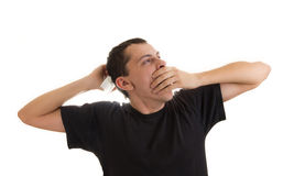 Man yawning and stretching Stock Photography