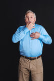 Man in years holding hand on chest Royalty Free Stock Photo