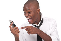 Man yelling at the cellphone. Young and black man yelling at the cellphone Royalty Free Stock Image