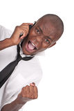 Man yelling at the cellphone. Young and black man yelling at the cellphone Royalty Free Stock Photography