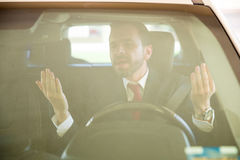 Man yelling and cursing while driving Stock Image