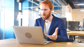 Frustrated Businessman Reacting to Problem at Work, Red Hairs Stock Photo
