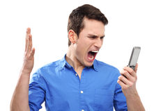 Man yelling at his mobile phone Royalty Free Stock Photography