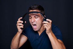 Man yelling while listening to headphones Stock Photos