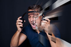 Man yelling while listening to headphones Royalty Free Stock Photo