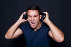 Man yelling while listening to headphones Royalty Free Stock Images