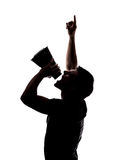 Man yelling in a megaphone. In silhouette isolated over white background Stock Photo