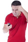 Man yelling at the phone. A young man angry and yelling at the phone Royalty Free Stock Images