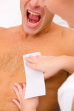 Man yelling while waxing Royalty Free Stock Photo
