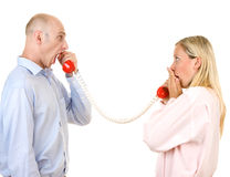 Man yelling at woman on phone Stock Photos