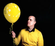 Yellow balloon Stock Images