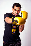 A man with yellow boxing gloves Stock Photo