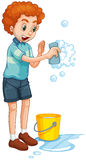 Man with yellow bucket and cleaning sponge Royalty Free Stock Photos