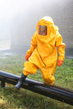 Man in yellow chemical suit. For cleaning operation Royalty Free Stock Photo