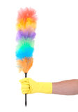 Man with yellow cleaning glove holding a duster Stock Images