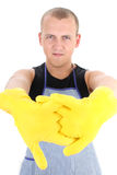 Man in yellow gloves Stock Photos