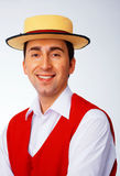 Man in yellow hat. And red waistcoat Stock Photography