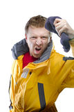 Man in yellow jacket Stock Images