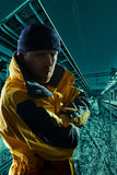 Man in yellow jacket in night Stock Photography