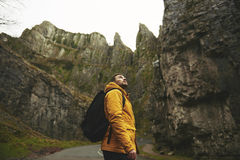 Man in Yellow Jacket Standing Royalty Free Stock Images