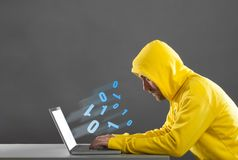 Man in a yellow jacket working on the Internet Royalty Free Stock Photography
