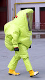 Man with yellow protective suit against biological risk Stock Images