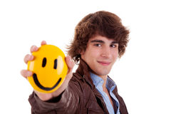 Man with a yellow smile face on hand Stock Images