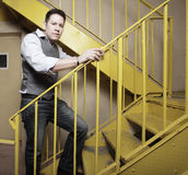 Man on a yellow staircase Royalty Free Stock Image