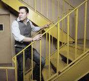 Man on a yellow staircase Stock Images