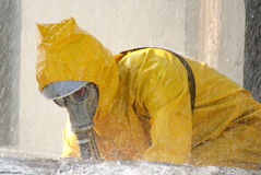 Man in a yellow suit, chemical protective. Man in a yellow chemical protection suit running in the rain Royalty Free Stock Photo