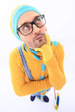A man in a yellow sweater and overalls stock photography