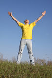 Man in yellow t-shirt. Give praise to God Royalty Free Stock Images